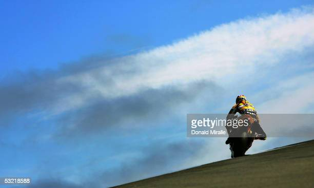 Valentino Rossi of Italy drives his Yamaham Factory Racing over a hill during morning practice for the 2005 Red Bull US Grand Prix part of the MotoGP...