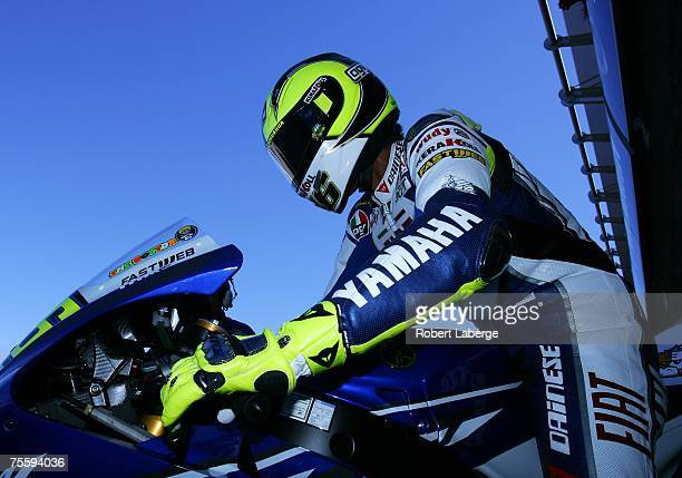 Valentino Rossi of Italy gets on his Team Fiat Yamaha before warmup for the 2007 Red Bull US Grand Prix part of the MotoGP World Championships at the...