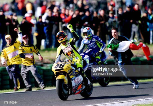 Valentino Rossi of Italy punches the air after winning the 2001 500cc Australian Motorcyle Grand Prix and clinching his first 500cc World Title, in...
