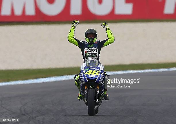Valentino Rossi of Italy rider of the Movistar Yamaha MotoGp Yamaha celebrates after winning the 2014 MotoGP of Australia at Phillip Island Grand...