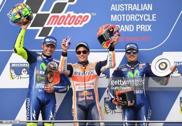 Valentino Rossi of Italy rides the MOVISTAR YAMAHA MotoGP Yamaha Marc Marquez of Spain who rode the REPSOL HONDA TEAM Honda and Maverick Vinales of...