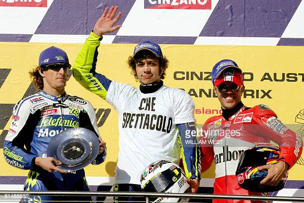 Valentino Rossi of Italy waves to the crowds after winning the Australian MotoGP Grand Prix at the Phillip Island circuit, some 130 kilometres...