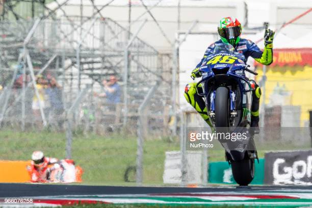 Valentino Rossi of Movistar Yamaha MotoGP celebrates the pole position performing a wheelie during the 2018 MotoGP Italian Grand Prix Qualifyng at...