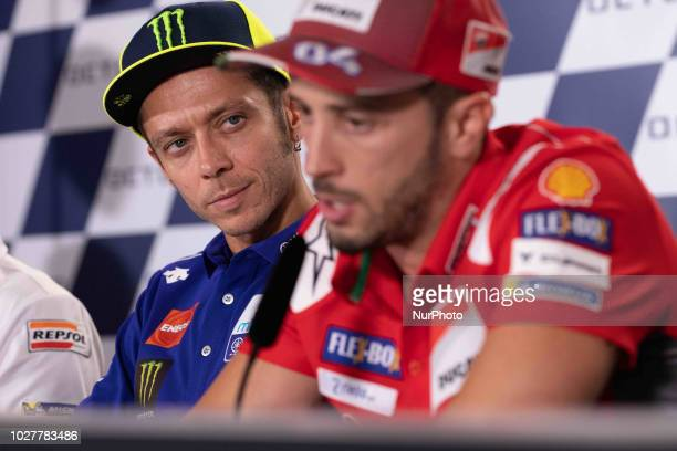 Valentino Rossi of Movistar Yamaha MotoGP looks Andrea Dovizioso of Ducati Team during the presentation press conference of the OCTO Grand Prix of...