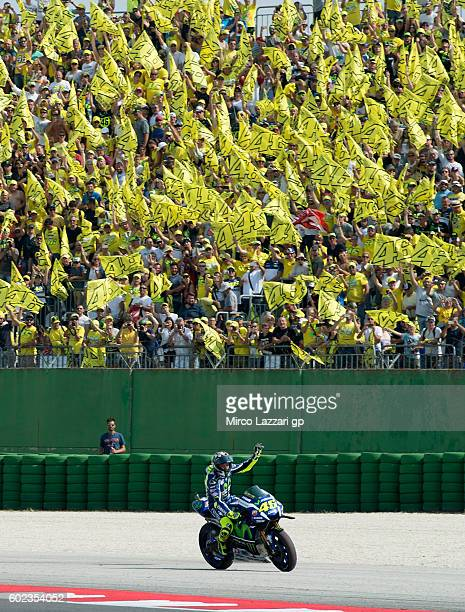 Valentino Rossi of Movistar Yamaha MotoGP team celebrates with fans after the MotoGP of San Marino race at Misano World Circuit on September 11 2016...
