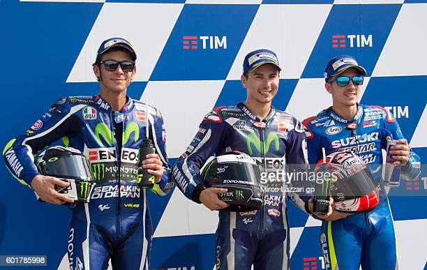 Valentino Rossi of Movistar Yamaha MotoGP team Jorge Lorenzo of Movistar Yamaha MotoGP and Maverick Vinales of Team SUZUKI ECSTAR pose for...