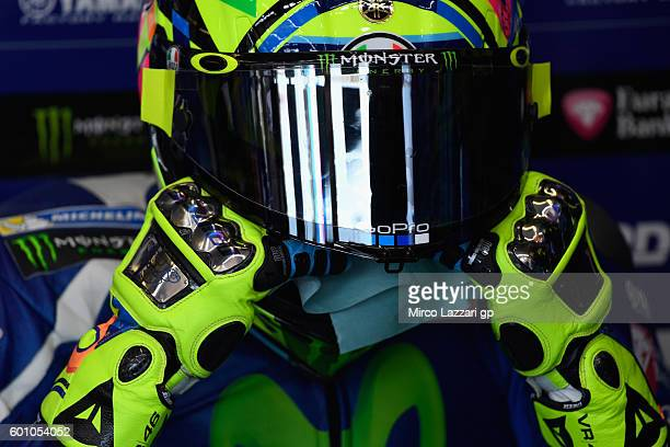 Valentino Rossi of Movistar Yamaha MotoGP wipes sweat off his face in his pit during MotoGP of San Marino Free Practice at Misano World Circuit on...