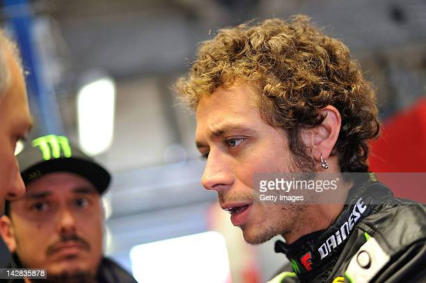 Valentino Rossi of Team Kessel Racing Ferrari 458 Italia looks on in the garage area during the Blancpain GT Endurance test day one at Autodromo di...