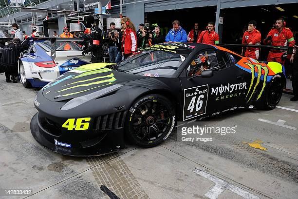Valentino Rossi of team Team Kessel Racing Ferrari 458 Italia drives out of the garage area during the Blancpain GT Endurance test day one at...
