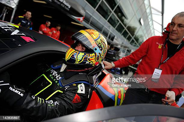 Valentino Rossi of team Team Kessel Racing Ferrari 458 Italia enters in the car in the garage area during the Blancpain GT Endurance test day one at...
