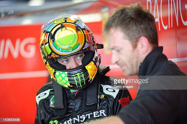 Valentino Rossi of team Team Kessel Racing Ferrari 458 Italia listen to mechanics in the garage area during the Blancpain GT Endurance test day one...
