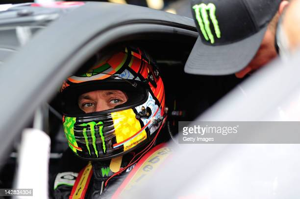Valentino Rossi of team Team Kessel Racing Ferrari 458 Italia sits in his car in the garage area during the Blancpain GT Endurance test day one at...
