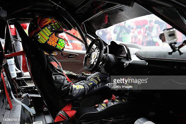 Valentino Rossi of team Team Kessel Racing Ferrari 458 Italia sits in his car during the Blancpain GT Endurance test day one at Autodromo di Monza on...