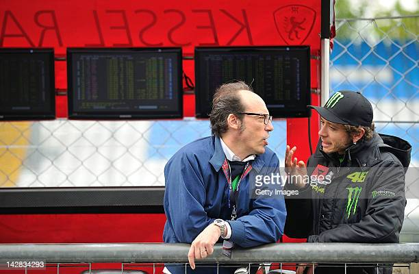 Valentino Rossi of team Team Kessel Racing Ferrari 458 Italia speaks to journalist Guido Meda during the Blancpain GT Endurance test day one at...