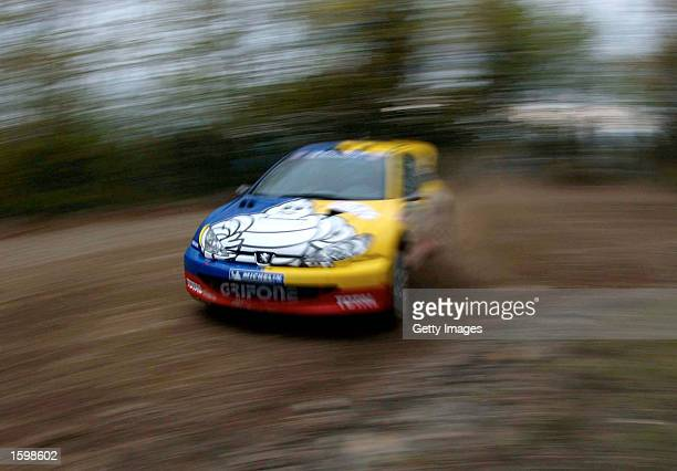 Valentino Rossi World Motorbike Champion test drives the Peugeot 206 WRC in in Colle della Nava Italy on October 18 2002 Rossi was testing the car in...