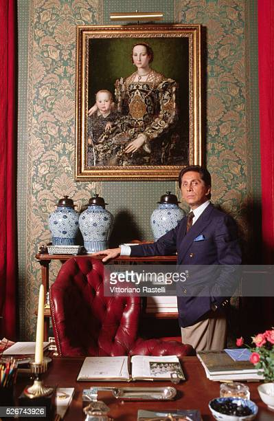 Valentino stands by a desk in his atelier in Rome Italy