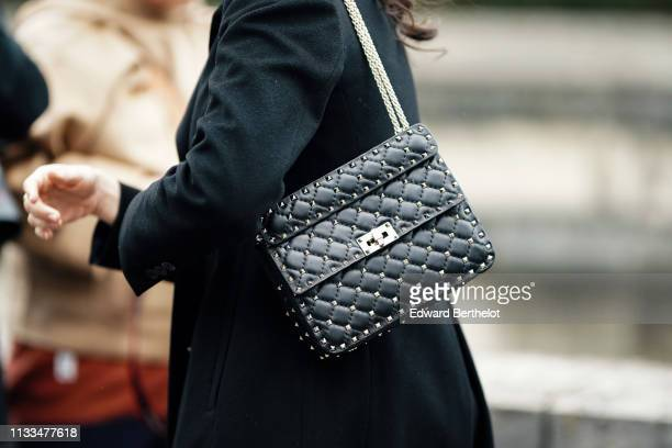 Valentino studded bag is seen, outside Valentino, during Paris Fashion Week Womenswear Fall/Winter 2019/2020, on March 03, 2019 in Paris, France.