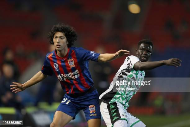 Valentino Yuel of Western United contests against Maki Petratos of the Newcastle Jets during the round 29 A-League match between the Newcastle Jets...