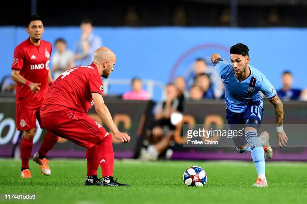 Valentín Castellanos of New York City FC controls the ball with pressure from Michael Bradley of Toronto FC at Yankee Stadium on September 11 2019 in...