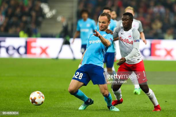 Valere Germain of Marseille and Diadie Samassekou of Salzburg during the Semi Final Second Leg Europa League match between RB Salzburg and Marseille...