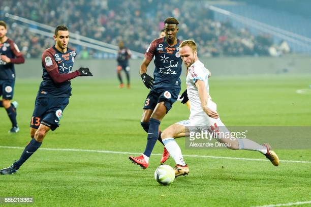 Valere Germain of Marseille and Ellyes Skhiri and Nordi Mukiele of Montpellier during the Ligue 1 match between Montpellier Herault SC and Olympique...
