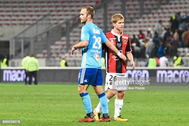 Valere Germain of Marseille and Vincent Koziello of Nice during the Ligue 1 match between OGC Nice and Olympique Marseille at Allianz Riviera on...