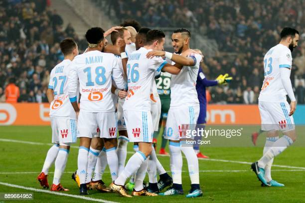 Valere Germain of Marseille celebrates scoring his side's first goal with teammates during the Ligue 1 match between Olympique Marseille and AS...