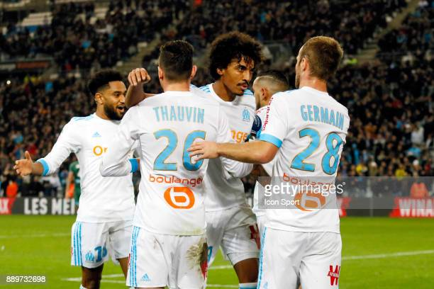 Valere Germain of Marseille celebrates scoring with teammates during the Ligue 1 match between Olympique Marseille and AS SaintEtienne at Stade...