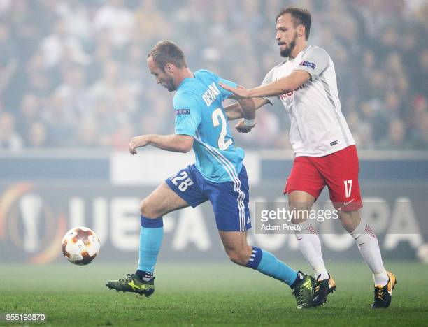 Valere Germain of Marseille is challenged by Andreas Ulmer of Red Bull Salzburg during the UEFA Europa League group I match between RB Salzburg and...
