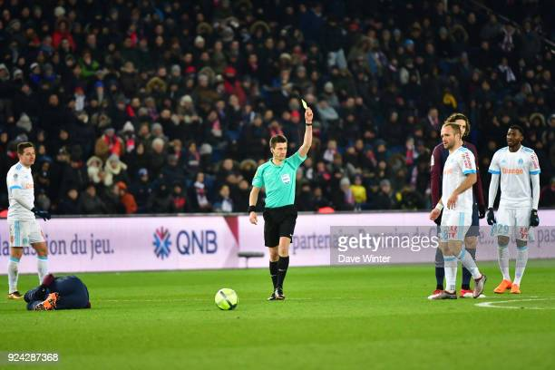Valere Germain of Marseille receives a yellow card from referre Benoit Bastien after a foul on Neymar JR of PSG during the Ligue 1 match between...