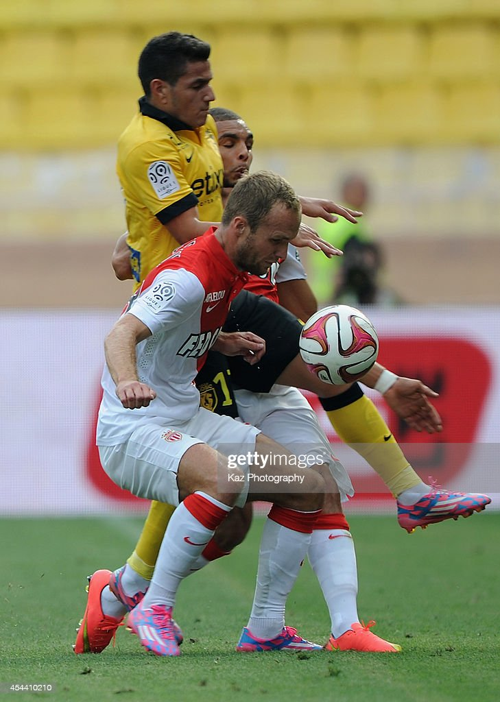 Valere Germain of Monaco and Marco Lopez of Lille compete for the ball during the French Ligue 1 match between AS Monaco FC and LOSC Lille at Louis II Stadium on August 30, 2014 in Monaco, Monaco.
