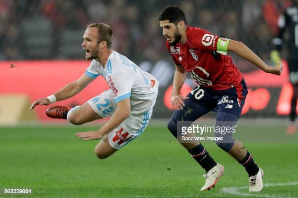 Valere Germain of Olympique Marseille Yassine Benzia of Lille during the French League 1 match between Lille v Olympique Marseille at the Stade...