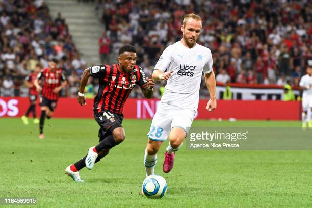 Valere Germain of OM and Patrick Burner of Nice during the Ligue 1 match between OGC Nice and Olympique de Marseille on August 28, 2019 in Nice,...