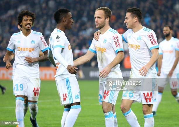 Valere Germain of OM celebrates his goal with Luiz Gustavo Bouna Sarr Florian Thauvin during the French Ligue 1 match between Olympique de Marseille...