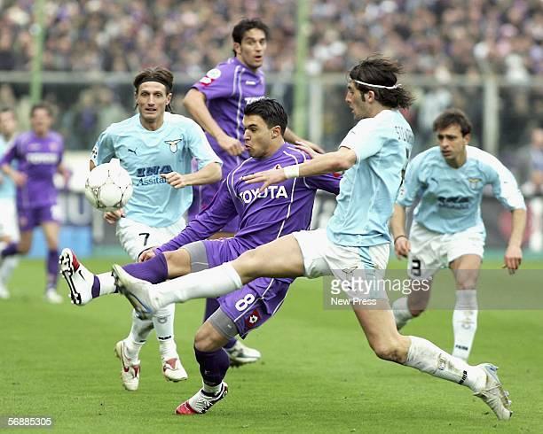 Valeri Bojinov of Fiorentina battles with Manuel Belleri and Guglielmo Stendardo of Lazio during the Serie A match between Fiorentina and SS Lazio at...