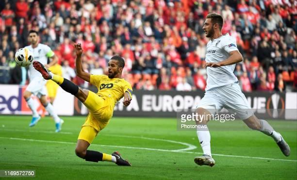 Valeri Bondorenko of Vitoria SC and Medhi Carcela midfielder of Standard Liege during the UEFA Europa League group F match between Standard Liege and...