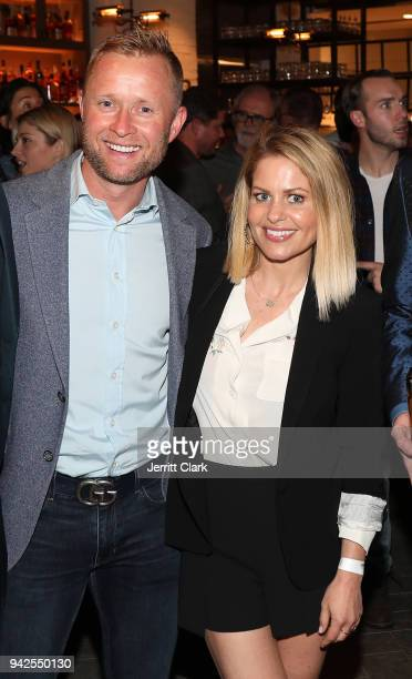 Valeri Bure and Candace Cameron-Bure attend the Yardbird Southern Table & Bar Los Angeles Grand Opening on April 5, 2018 in Los Angeles, California.