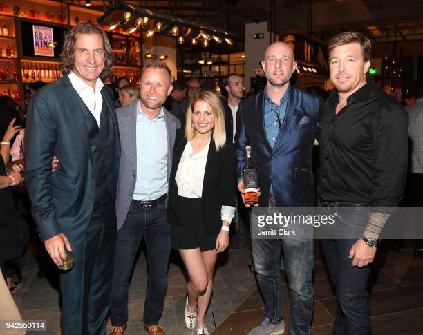 Valeri Bure and Candace CameronBure pose with Yardbird founder John Kunkel and guests at the Yardbird Southern Table Bar Los Angeles Grand Opening on...