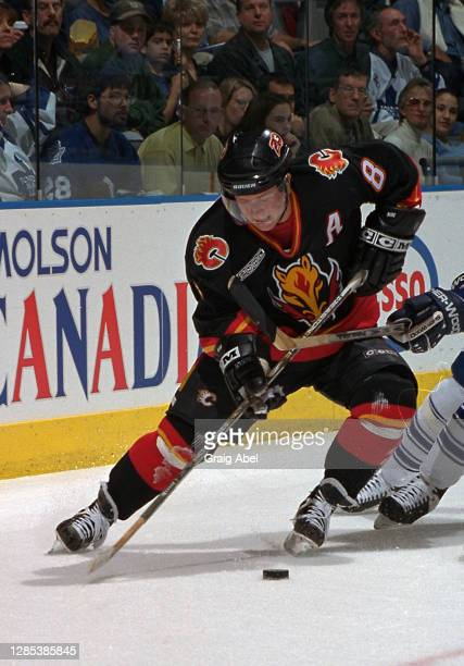 Valeri Bure of the Calgary Flames skates against the Toronto Maple Leafs during NHL game action on October 30, 1999 at Air Canada Centre in Toronto,...