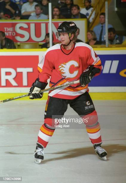 Valeri Bure of the Calgary Flames skates against the Toronto Maple Leafs during NHL game action on November 23, 1998 at Maple Leaf Gardens in...