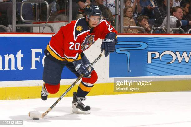 Valeri Bure of the Florida Panthers looks to pass the ball during a NHL hockey game against the Washington Capitals at MCI Center on January 11, 2003...