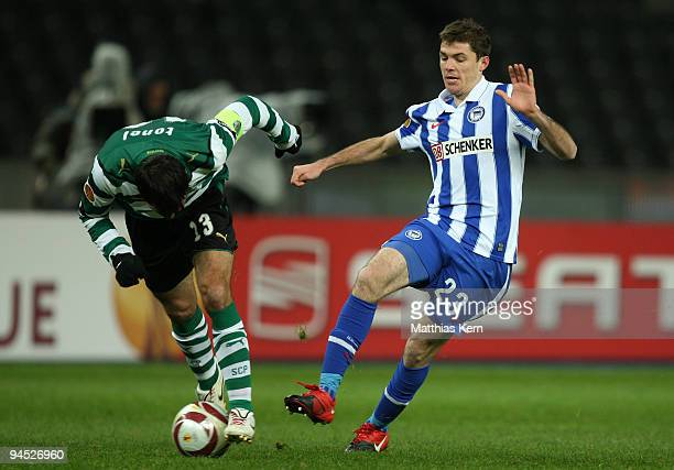 Valeri Domovchiyski of Berlin battles for the ball with Leandro Grimi of Lissabon during the UEFA Europa League match between Hertha BSC Berlin and...