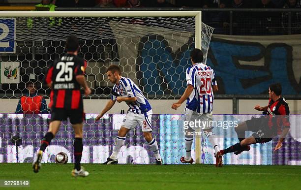 Valeri Domovchiyski of Hertha scores his team`s first goal during the UEFA Europa League group D match between SC Heerenveen and Hertha BSC Berlin at...