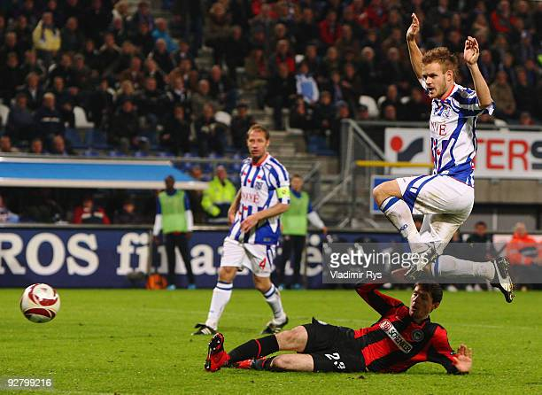 Valeri Domovchiyski of Hertha scores his team`s second goal as a defender Kristian Bak Nielsen of Heerenveen jumps over during the UEFA Europa League...