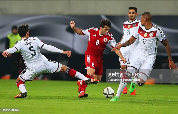 Valeri Kazaishvili of Georgia takes on Mats Hummels Ilkay Gundogan and Jerome Boateng of Germany during the UEFA EURO 2016 Group D qualifying match...