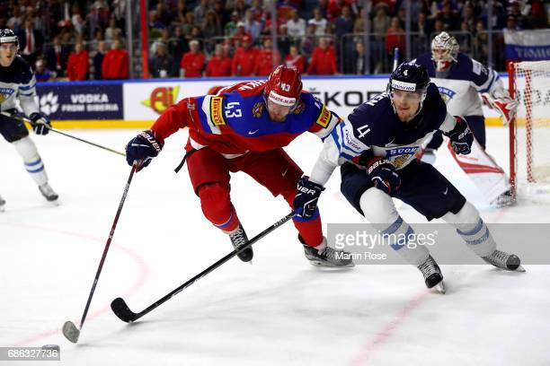 Valeri Nichushkin of Russia challenges Mikko Lehtonen of Finland for the puck during the 2017 IIHF Ice Hockey World Championship Bronze Medal game...