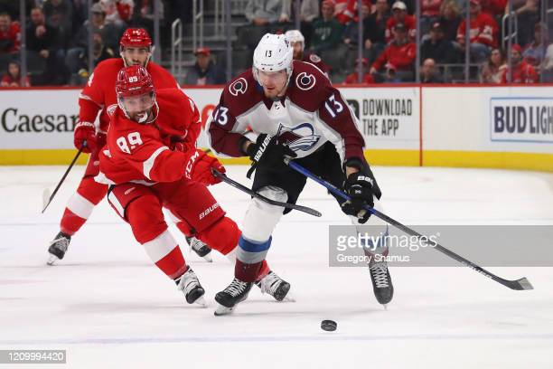 Valeri Nichushkin of the Colorado Avalanche tries to get around the stick of Sam Gagner of the Detroit Red Wings during the first period at Little...