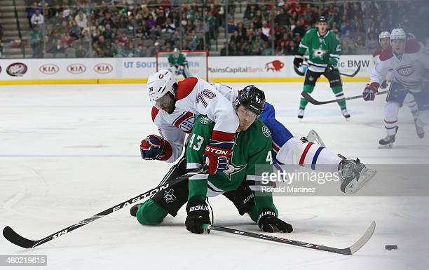 Valeri Nichushkin of the Dallas Stars falls on the ice with PK Subban of the Montreal Canadiens in the first period at American Airlines Center on...