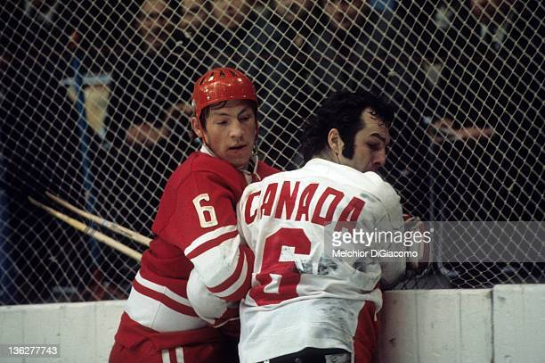 Valeri Vasiliev of the Soviet Union battles with Ron Ellis of Canada along the boards during the 1972 Summit Series at the Luzhniki Ice Palace in...