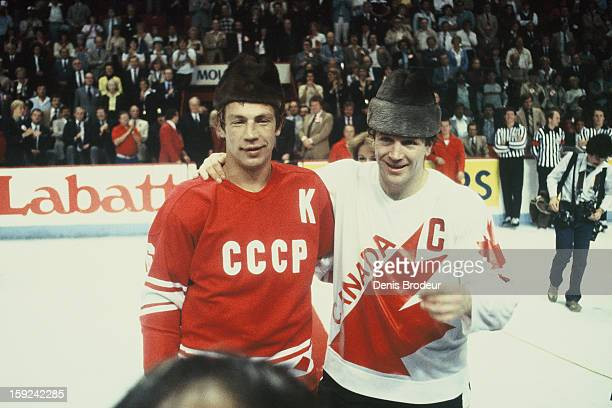 Valeri Vasilyev of the Soviet Union team and Denis Potvin of team Canada pose for a photo after a Canada Cup game held at the Montreal Forum circa...